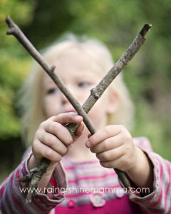 Making the letter X out of two tree branches.