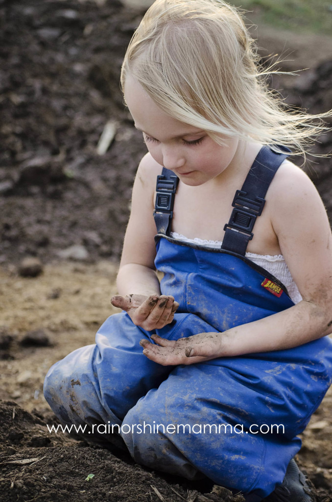 Child playing in dirt.