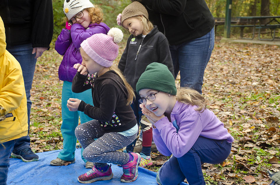 Kids singing and playing at a Tinkergarten class in Indiana.