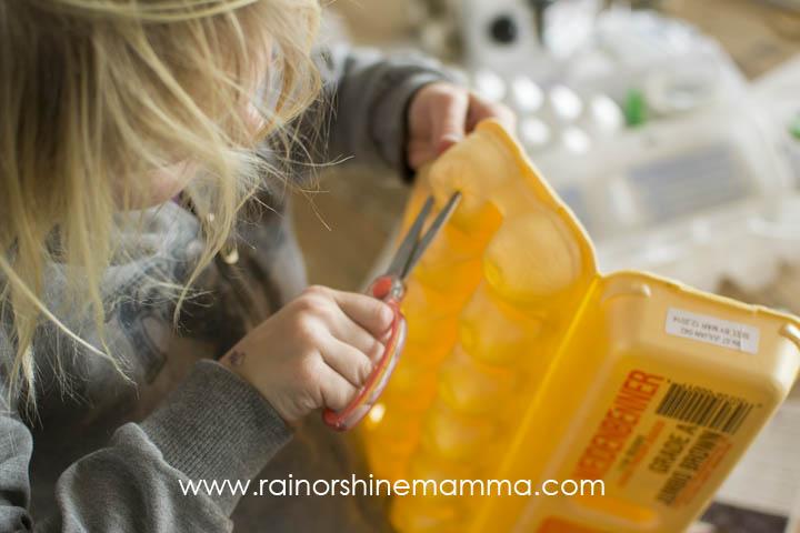 Cutting Holes in the Egg Carton Seed Starter. Rain or Shine Mamma