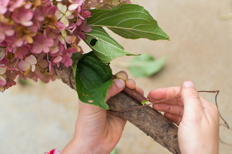 Make a Beautiful Hiking Stick from Nature. A fun nature activity that fits both younger and older kids. Rain or Shine Mamma. #naturecraft #natureactivities #nature #forestschool